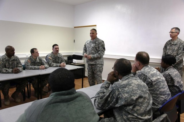 Lt. Gen. Jack C. Stultz, (standing center) the commanding general of the Army Reserve, talks to Soldiers of the 406th Human Resources Company, 7th Civil Support Command about the new changes to active and reserve Army structure on Daenner Kaserne in Kaiserslautern, Germany Feb. 11. Stultz explained that both President Barack Obama and Congress have asked him to increase the relevance of an operational reserve as part of the total Army force package for support functions like transportation, medical, military police, engineering and civil affairs.