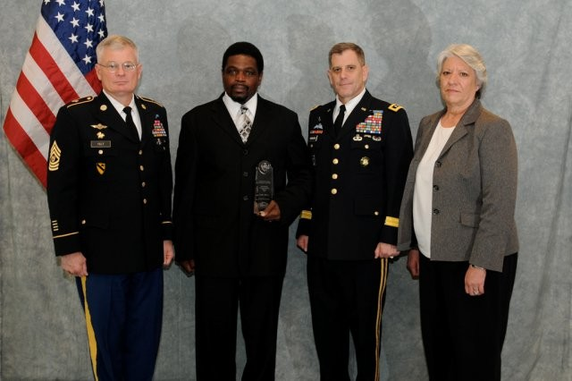 Leon Terry, third from the left, receives his award at a conference in San Diego, Feb. 2. He was presented the award by Lt. Gen. Michael Ferriter, IMCOM commander, right, and by IMCOM Command Sgt. Maj. Donald Felt, left.