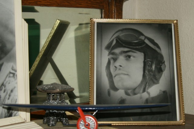 FORT CARSON, Colo. -- On the curio in Franklin Macon's living room sits a portrait of the young pilot and a model airplane.