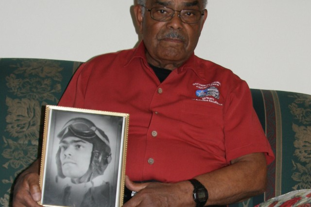 FORT CARSON, Colo. -- Franklin Macon holds a portrait of himself at age 19. Macon, one of the original Tuskegee Airmen, worked at Fort Carson for 22 years.