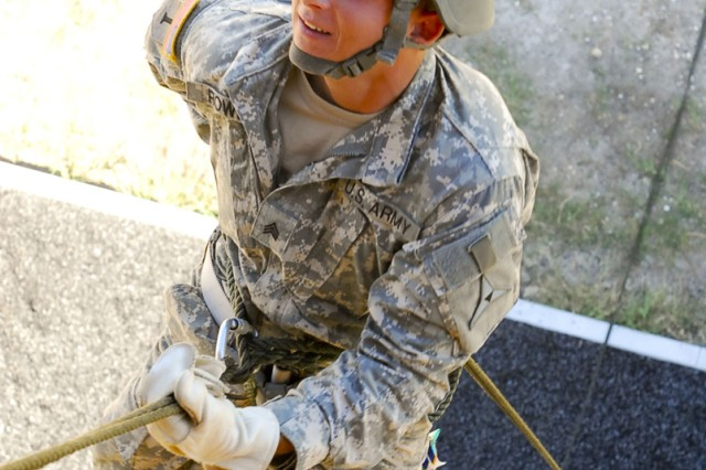 Sgt. Jacob Rowe, Headquarters Support Company, III Corps Headquarters and Headquarters Battalion, begins his decent down a 50-foot rappel tower, Oct. 25, 2011, at Fort Hood, Texas.
