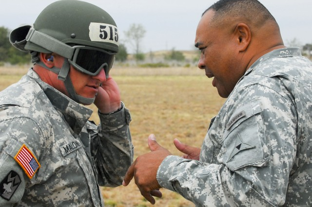 Capt. Samuel Malone, 180th Transportation Battalion, 4th Sustainment Brigade, 13th Sustainment Command (Expeditionary), speaks with III Corps and Fort Hood Command Sgt. Major Arthur L. Coleman Jr. after completing his rappel from an Army helicopter Oct. 27, 2011, at Fort Hood, Texas.