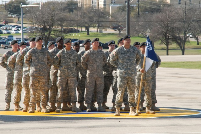 Soldiers with Company A, Headquarters and Headquarters Battalion, III Corps, stand in formation during a change of responsibility ceremony on Sadowski Field at Fort Hood, Texas. A new Army directive, signed by Secretary of the Army John McHugh Feb. 2, 2012, goes into effect March 1, aimed at retaining a quality force.