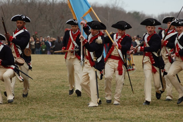 The Commander in Chief's Guard composed of Soldiers from Company A, 4th Battalion, 3rd U.S. Infantry (The Old Guard) demonstrate military tactics during the era of Gen. George Washington's Continental Army on the bowling green at Washington's Mount Vernon Estate during the 2011 Presidents Day celebrations.