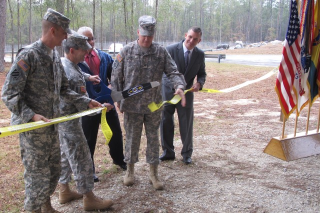 Brig. Gen. William T. Wolf, with scissors, second from left, leads the ribbon cutting at the Crash Dynamics Lab, Feb. 14. Left to right, Command Sgt. Maj. Richard Stidley, command sergeant major, U.S. Army Combat Readiness/Safety Center; Perry Alliman, Col. James Baker and Mike Wesolek, all with the USACR/Safety Center. The Crash Dynamics Lab was developed and built by the USACR/Safety Center, and actual crashed aircraft and vehicles are displayed so students undergoing accident investigator training can learn accident investigation procedures.