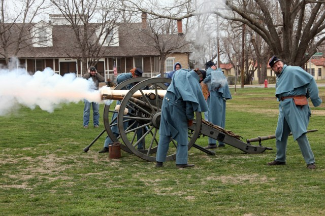 The Field Artillery Museum Muzzle Loading Gun Crew fires an 1841 6-pound field gun Feb. 11 at the Old Post Quadrangle on Fort Sill. The demonstration depicted Army field artillery in the early 1870s. Only blanks were fired during the demonstration.