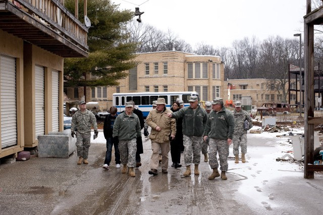 "Indiana Adjutant General Maj. Gen. R. Martin Umbarger points out a feature of the mock middle eastern market place to Acting Assistant Secretary of Defense for Reserve Affairs David L. McGinnis as Lt. Gen. J. M. ""Mick""  Bednarek, Commanding General of the First United States Army, and Indiana Assistant Adjutant General Maj. Gen. Clif Tooley at Muscatatuck Urban Training Center during a tour of the facility on Tuesday, Feb. 14."
