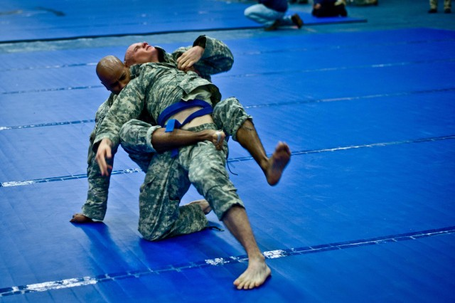 Staff Sgt. Carlos O. Padilla, a civil affairs noncommissioned officer assigned to Headquarters and Headquarters Company, 85th Civil Affairs Brigade attempts to apply a choke hold on his opponent during the 2012 Fort Hood Combatives Championship preliminaries Feb. 13 at the Abrams Physical Fitness Center on base.