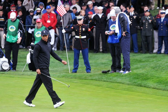 PEBBLE BEACH, Calif. - Tiger Woods prepares to putt at Pebble Beach's 15th hole Feb. 11. Woods returned to play in the AT&T golf tournament for the first time in 10 years.