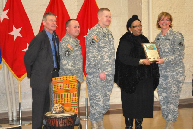 Maj. Gen. Patricia McQuistion, ASC commanding general, along with Command Sgt. Maj. James Spencer, First Army Brig. Gen. Kendall Penn and Joel Himsl, garrison manager, present recognition to guest speaker Rev. Beverly Smith at the Black History Month Observance, Feb. 16, at Heritage Hall in Rock Island, Ill.