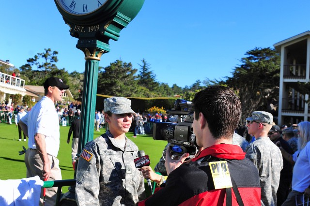 PEBBLE BEACH, Calif. - Pfc. Courtney Neuman, 229th Military Intelligence Battalion, is interviewed by a news team on Feb.8, during Military Day at the AT&T Pebble Beach National Pro-Am. Active-duty service members, law enforcement and firefighters, along with one guest, were given free admission for the day by the tournament to show their appreciation.