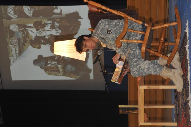 Brig. Gen. Nadja West, Commanding General, Europe Regional Medical Command, reads aloud during the Tell Me A Story event at Patrick Henry Elementary School in Heidelberg, Germany Feb.12.