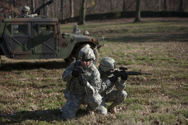 Spc. Levi Draper, left, and Sgt. Jillian Blue, right, from the 289th Military Police Company with The Old Guard, practice security stops on Joint Base Myer-Henderson Hall near McNair Road on Dec. 8 during training.