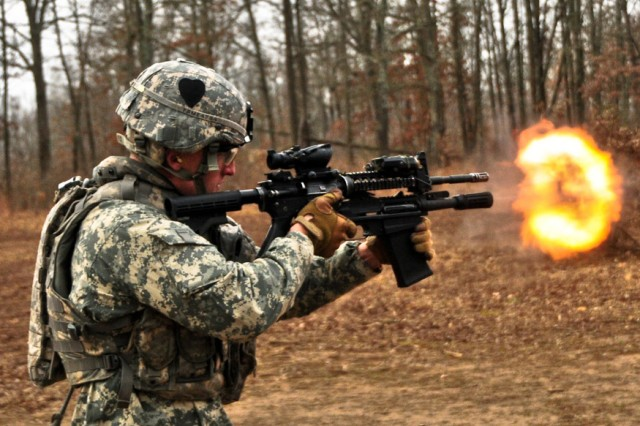 Sgt. Vincent Mennell, a combat engineer with Company A, 2nd Brigade Special Troops Battalion, 2nd Brigade Combat Team, 101st Airborne Division (Air Assault), fires the newly issued M26 Modular Accessory Shotgun System at Range 44b on Fort Campbell, Ky., Feb. 10, 2012. The 2nd BCT, also known as the Strike Brigade, is the first unit in the Army to be issued the future weapon.