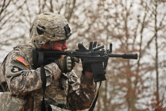 Sgt. Rhys McMahon, a combat engineer with Company A, 2nd Brigade Special Troops Battalion, 2nd Brigade Combat Team, 101st Airborne Division (Air Assault), fires the stand alone version of the M26 Modular Accessory Shotgun System at Range 44b on Fort Campbell, Ky., Feb. 10, 2012.