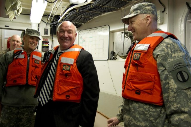 Assistant Secretary of the Army (Manpower and Reserve Affairs) Thomas R. Lamont shares a laugh with Gen. Bob Cone, TRADOC commander while touring the Army Transportation School's Maritime and Intermodal Training Department Simulation Training Facility at Fort Eustice, Va., Feb. 10.