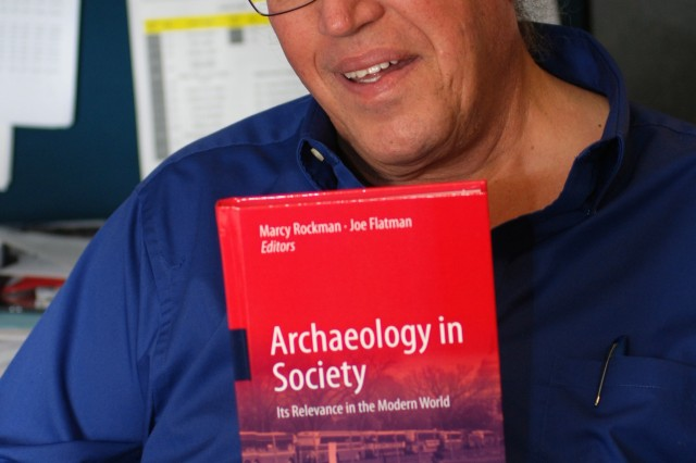 "Richard Perry, archaeologist with the U.S. Army Corps of Engineers Sacramento District, poses in Sacramento, Calif., Feb. 15, 2012 with the recently published book, ""Archaeology in Society"". Perry's study of prehistoric and historic sites at a former target range at Honey Lake, Calif., is featured in the book."