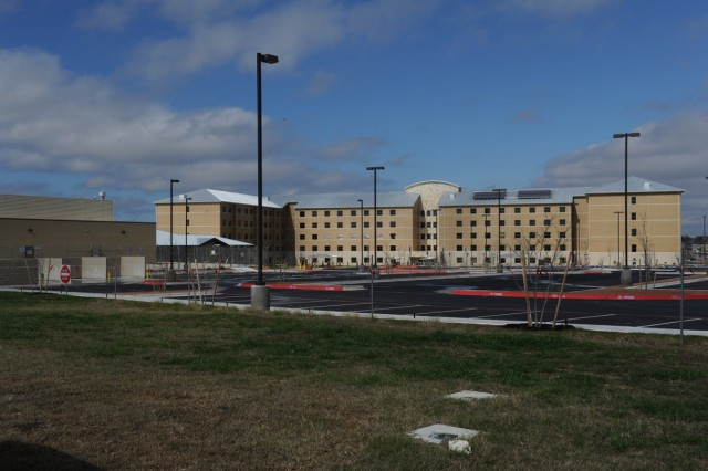 A new barracks building for Fort Hood's Warrior Transition Brigade is slated to open in May. The barracks will consist of 320 rooms and cost almost $41 million to build, according to Kristina Manning, Fort Hood DPW. This building is the final stage of the new campus for the WTB, which also includes a new Soldier and Family Assistance Center, new company areas and a battalion headquarters building. The new campus will consolidate the WTB footprint on the installation. (U.S. Army photo by Heather Graham-Ashley, III Corps and Fort Hood Public Affairs)