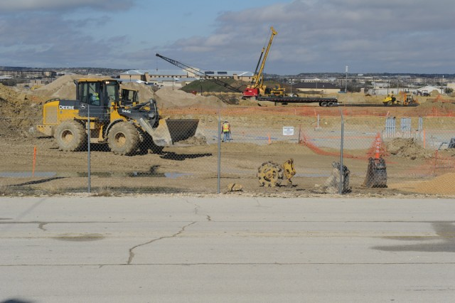 Work crews smooth an area at Fort Hood's new medical center site. At a cost of more than $550 million to build, the project is the post's largest. (U.S. Army photo by Heather Graham-Ashley, III Corps and Fort Hood Public Affairs)