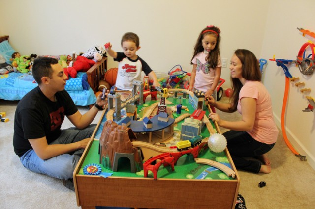 JOINT BASE LEWIS-MCCHORD, Wash. (January 28, 2012) Matthew, Maverick, Mallorie and Maelisa Sanchez play with Maverick's train set in their Town Center home, Jan. 28.