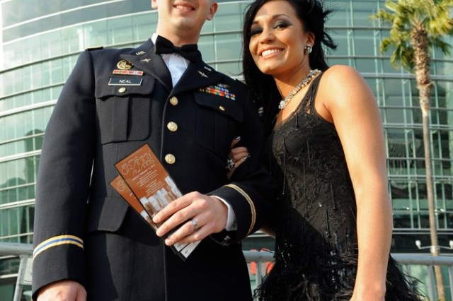 """""""Operation Rising Star"""" winner Melissa Neal and her husband Chief Warrant Officer 2 Nate Neal pose outside the Staples Center where they attended the Grammy Awards Sunday night."""