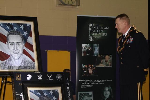 Maj. Gen. Roger F. Mathews, Deputy Commanding General, U.S. Army Pacific, looks at the newly created portrait of the late 1st Lt. Jonathan Brostrom during a dedication ceremony Feb. 17 at Damien Memorial High School in Honolulu. The portrait was courtesy of the American Fallen Soldier project, a national non-profit organization that honors and forever memorializes fallen service members through paintings. Brostrom was a platoon leader assigned to 2nd Battalion, 503rd Infantry Regiment, 173rd Airborne Brigade Combat Team, and died from wounds sustained during Operation Enduring Freedom July 13, 2008. Brostrom was a graduate of Damien High School, a recipient of one of the paintings, and the University of Hawaii. Mathews delivered a message from U.S. Army Pacific, thanking Brostrom and his family for making the ultimate sacrifice in defense of our nation.