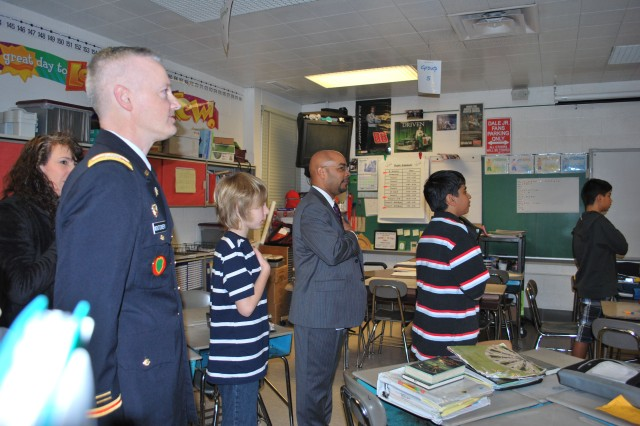 CECOM Chief of Staff, Col. William 'Bill' Montgomery, recites the pledge of allegiance in unison with Havre de Grace Middle School students Feb. 14, before speaking at a honors breakfast recognizing students who achieved a 3.5 grade point average or better in the last report card rating cycle.