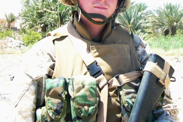 Then-Marine Lance Cpl. Dario DiBattista, now a Veterans Writing Project instructor and accomplished writer, pauses for a photo while on patrol in Al Qa'im, Iraq, in May 2004.