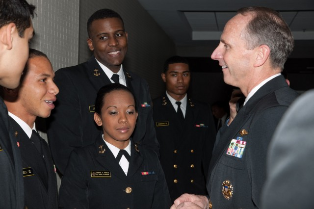 U.S. Navy Chief of Naval Operations Adm. Jonathan Greenert, right, greets a group of young sailors prior to attending the Stars & Stripes Dinner and the 26th annual BEYA Experience in Philadelphia Feb. 17.