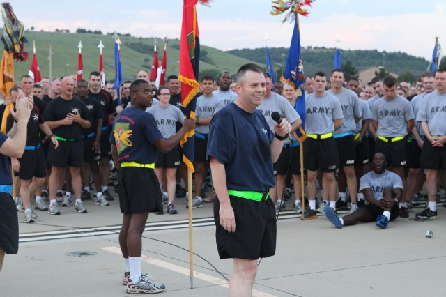 Command Sgt. Maj. Jim Thomson speaks to the Soldiers of the CAB following a brigade run at Marshall Army Airfield Sept. 1, 2011.