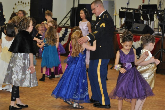 Daughters step onto the dance floor and cut a rug while waiting for their fathers to step out and join the fun at the Fort Leonard Wood Father Daughter Ball at Nutter Field House Saturday.