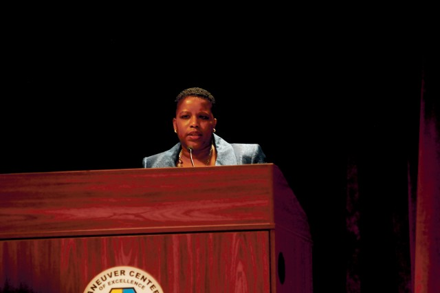 Retired Lt. Col. Shatrece Buchanan speaks at the Black History Month Observance Feb. 14 at McGinnis-Wickam Hall. Buchanan discussed  the importance of leveraging diversity in the military, learning to care for others and mentoring.