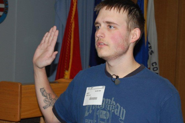 David West II takes the enlistment oath. The Plato, Mo., native lost more than 100 pounds to be able to enlist in the Army.