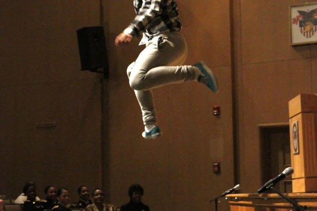 "Class of 2015 Cadet Enoch Lau rises to new heights during the Black History Month Observation event at Robinson Auditorium. Before the leap, he joined other cadets on stage, dancing to DJ Renegade's ""That and Some Mo."" The 2012 Black History Month Observance at West Point featured powerhouse performances by cadets at Robinson Auditorium on Feb. 15."