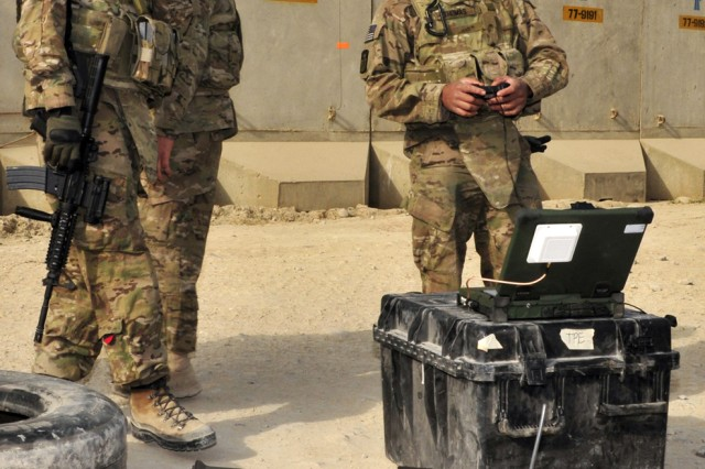 Spc. Hanson W. Thomas, a member of the 10th Sustainment Brigade personal security team, takes a turn controlling a Packbot during training on Bagram Airfield, Afghanistan. The Packbots are being fielded by the brigade as a counter-IED measure.