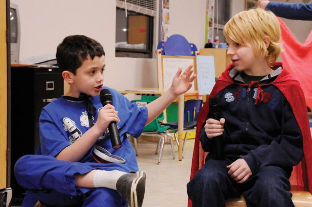 Jared Miedema, 9, left, and Dominik Glathar, 12, perform a stand-up comedy routine during teh SKIES Unlimited program's drama and theater session.