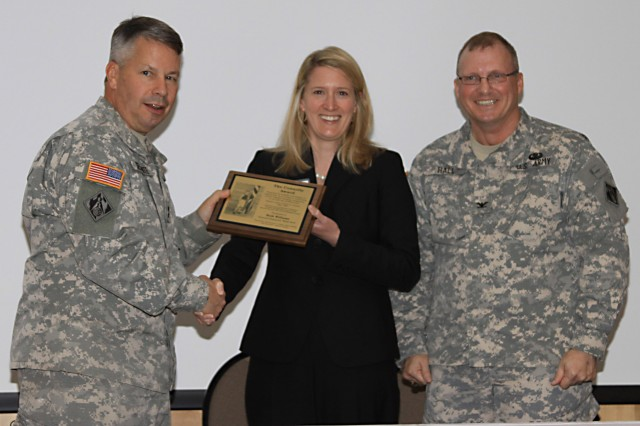 Maj. Gen. Todd Semonite, Commander of the U.S. Army Corps of Engineers South Atlantic Division, presents Beth Williams with the prestigious Connolly Award at the Savannah E-Week Technical Training Conference, Feb. 22, 2012. Right: Col. Jeff Hall, USACE Savannah District Commander and SAME Savannah Post President. USACE Photo by George Jumara.