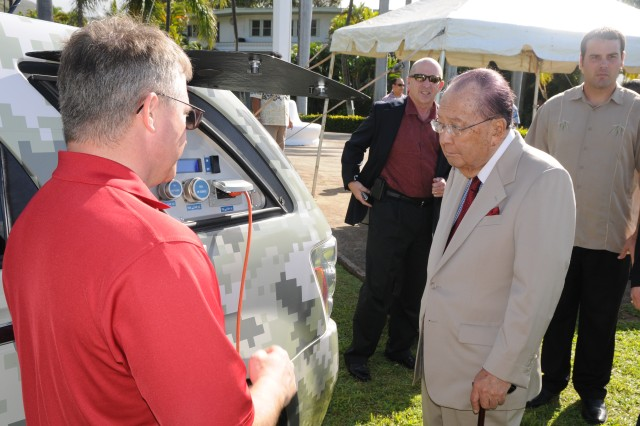 James Muldoon, science officer, U.S. Army Pacific, explains hydrogen fuel cell technology to Sen. Daniel Inouye, Feb. 22, 2012, during a commissioning ceremony at Fort Shafter, Hawaii. The vehicle in the image generated the electricity needed to power the public address system during the ceremony.