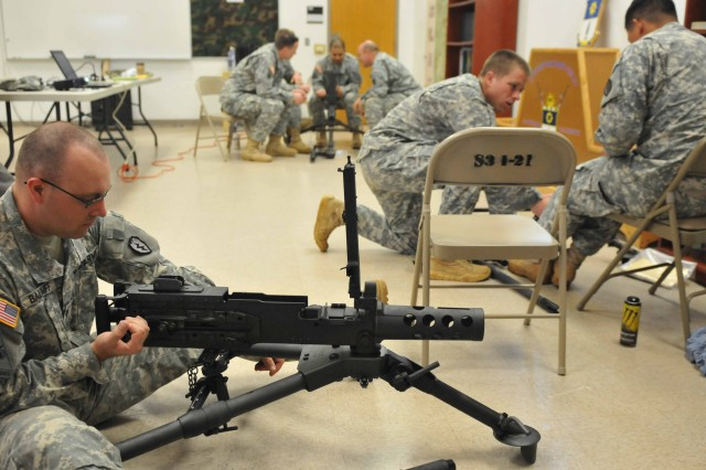 "SCHOFIELD BARRACKS, Hawaii "" Soldiers from the 2nd Brigade Combat Team, 25th Infantry Division, practice clearing procedures for the M2A1 machine gun during a familiarization course on Feb. 8 at Schofield Barracks, Hawaii. The course covered characteristics and operating procedures for the revised machine gun that replaced the older version, the M2 machine gun."