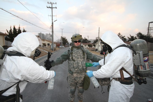 """The training episode was one of numerous terror incidents staged during antiterrorism exercise ADAPTIVE FOCUS, held Feb. 15-16 at Area I installations. Along with the 2nd Infantry Division and U.S. Army Garrison Red Cloud, South Korean troops and civil authorities took part. """" U.S. Army Photo by Kevin Jackson"""