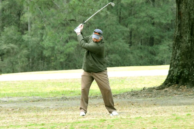 Drik Williford, civilian, takes a swing while he plays a round of golf with his friends at the Silver Wings Golf Course Feb. 17.
