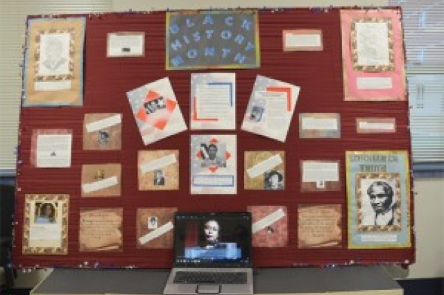 The 5th Platoon from Bravo Company, 16th Ordnance Battalion, earned second place in their company-wide competition for their Black History display honoring women with cultural or military ties. Their display featured hand-drawn portraits and a electronic slideshow.