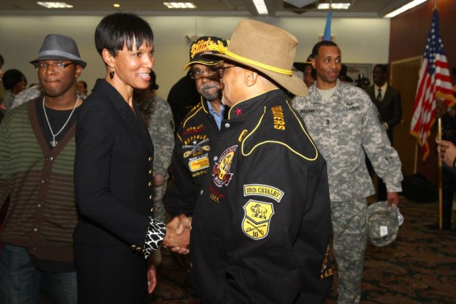 Cassandra Chandler, guest speaker at the Fort Sill Black History Month Luncheon, shakes hands with attendees Feb. 16 at the Patriot Club. She shared how attitude and expectations helped her be a trailblazer not only in her current position as senior vice president at Global Corporate Security, but also in her 23 years in the FBI. She said it is those two things that have been the driving force behind all black women who have made history. More photos from the event are at: http://www.flickr.com/photos/fortsillcannoneer/sets/72157629349957271/