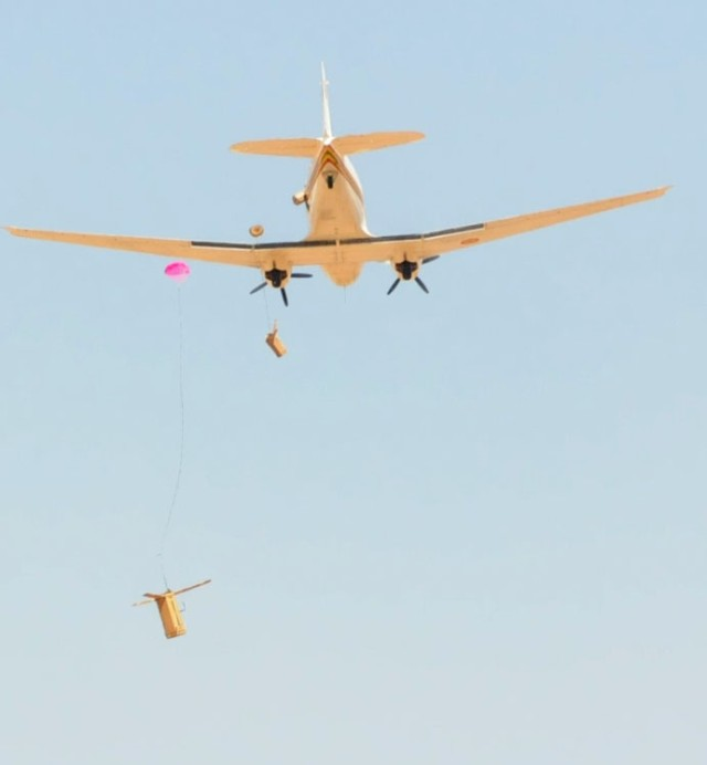 Malian BT-67 Drops Helicopter Boxes