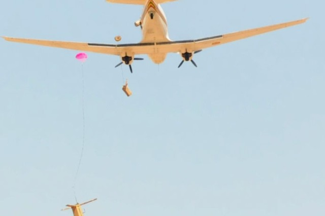 A Malian air force BT-67 drops helicopter boxes as part of aerial re-supply training during operation Atlas Accord near Mopti, Mali, Feb. 13, 2012.