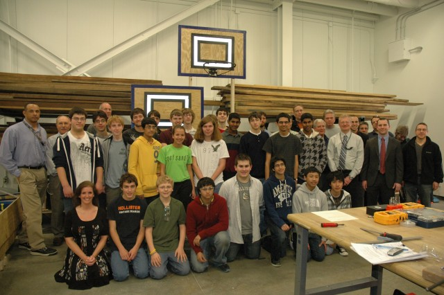 Members of Team 1980 and their mentors pose for a final photo before concluding their work. The students briefed their project and thanked their CERDEC mentors during a Feb. 15 presentation at Aberdeen Proving Ground. Shortly after, the robot was sealed and shipped off to Baltimore for the regionals, which take place March 8-10.