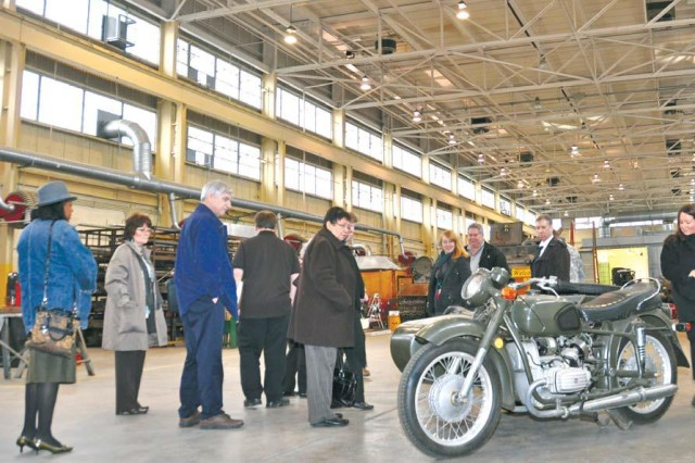 Members of the Aberdeen Proving Ground, Md., Museum council look at a restored Soviet World War II-era motorcycle during a Jan. 26, 2012, tour of the Restoration Facility.