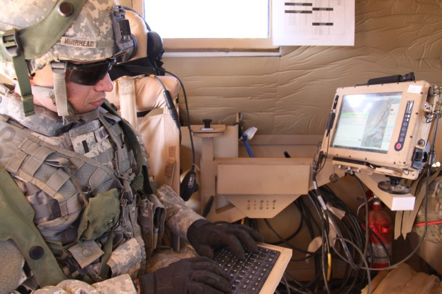 A 2nd Brigade, 1st Armored Division Soldier uses the new chat feature of the Joint Capabilities Release of Force XXI Battle Command Brigade and Below/Blue Force Tracking during NIE 12.1 in November 2011. Joint Capabilities Release Chat works like an online chat room within FBCB2, allowing users to instant-message in real time over the BFT 2 satellite network. Joint Capabilities Release is part of Capability Set 13.
