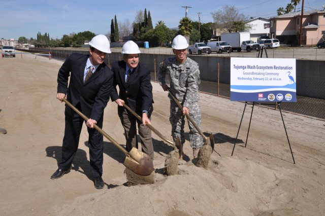 Los Angeles County Public Works Deputy Director Mark Pestrella, Los Angeles County Supervisor Zev Yaroslavsky and Los Angeles District Commander Col. Mark Toy ceremonially turn dirt Feb. 22 for the start of the $7 million Tujunga Wash Ecosystem Restoration project that will extend greening along the sides of a 3/4-mile stretch of concrete channel in the San Fernando Valley that carries runoff from Hansen Dam to the Los Angeles River.