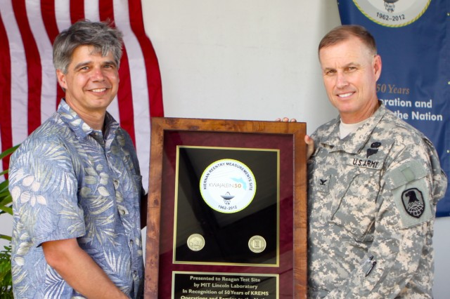 MIT/LL Director Eric Evans, left, presents a plaque to USAKA Commander Col. Joseph Gaines to celebrate 50 years of service for KREMS radars Feb. 12.